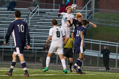 Maloney's Flint Rich wins a header off a corner kick Wednesday during the quarter final round of the CIAC Class L tournament at Falcon Field in Meriden  November 8, 2017 | Justin Weekes / For the Record-Journal