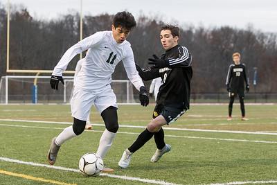 Maloney's Josue Urena works past Daniel Hand's Matthew Cifarelli Sunday during the CIAC Class L finals at Rosek-Skubel Stadium on the campus of Middletown High School in Middletown November 18, 2018 | Justin Weekes / Special to the Record-Journal