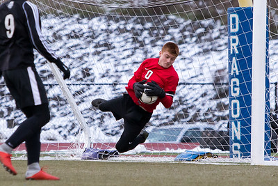 Maloney's Devin Juan saves a shot Sunday during the CIAC Class L finals at Rosek-Skubel Stadium on the campus of Middletown High School in Middletown November 18, 2018 | Justin Weekes / Special to the Record-Journal