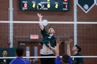 Maloney's Michael Coitrone cuts a spike past blockers Wednesday at Maloney High School in Meriden April 25, 2018 | Justin Weekes / Special to the Record-Journal
