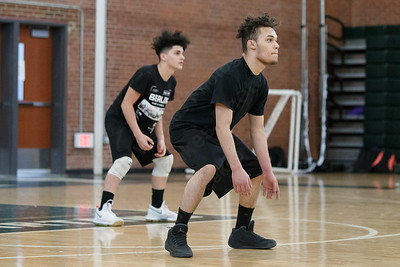Maloney's Marcos Ortiz right and Adrian Suarez gets set for a serve Friday during a pre-season scrimmage with Amity at Maloney High School in Meriden March 23, 2018 | Justin Weekes / Special to the Record-Journal