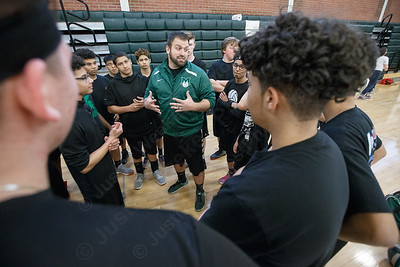 Maloney's head coach Kevin Savejs talks with the team Friday during a pre-season scrimmage with Amity at Maloney High School in Meriden March 23, 2018 | Justin Weekes / Special to the Record-Journal