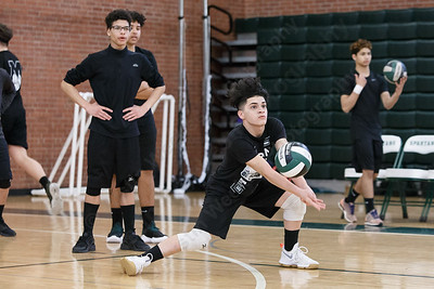 Maloney's Adrian Suarez digs a ball in warm ups Friday during a pre-season scrimmage with Amity at Maloney High School in Meriden March 23, 2018 | Justin Weekes / Special to the Record-Journal