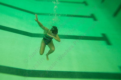 """Meriden's Jocelyn Rodriguez give a little """"dab"""" underwater on senior night Tuesday at Maloney High School pool in Meriden October 24, 2017 