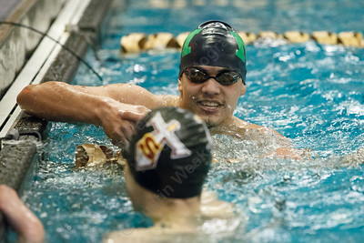 Sheehan's Adam DiDomenico congratulates Meriden co-op's Julio G Hernandez  after the win Tuesday at the Platt High School Natatorium in Meriden February 6, 2018 | Justin Weekes / Special to the Record-Journal