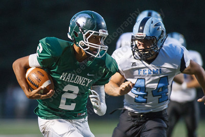 Maloney's Chris Dingwell (2) runs in a touchdown on a quarterback keeper past Fermi's Charles Fields (44) Friday at Falcon Field in Meriden September,19 2014 | Justin Weekes / For the Record-Journal