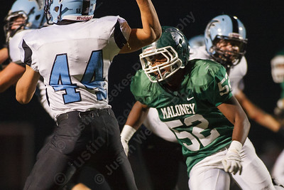 Maloney's Twyman Miller (52) rushes Fermi's Charles Fields (44) Friday at Falcon Field in Meriden September,19 2014 | Justin Weekes / For the Record-Journal