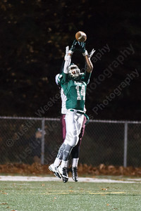 Maloney's Jakai Whittingham (14) comes up with an interception over Bristol Central's Connor Staubley (87) Friday at Falcon Field in Meriden Nov 7, 2014 | Justin Weekes / For the Record-Journal