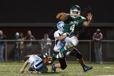 Maloney's Handy Ellison (4) breaks a tackle from Fermi's John Viverios (82) and Mike Thayer (84) to score  Friday at Falcon Field in Meriden September,19 2014 | Justin Weekes / For the Record-Journal
