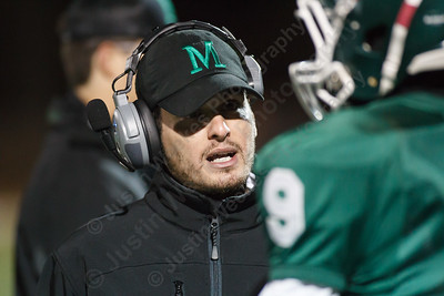 Maloney's head coach Kevin Frederick speaks with Cam Quinonez (9) on the sidelines Friday at Falcon Field in Meriden Nov 7, 2014 | Justin Weekes / For the Record-Journal