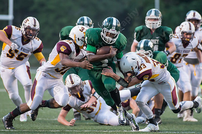 Maloney's Jaron Cogdell (4) finds some room in the middle of South Windsor's defense Friday at Falcon Field in Meriden Sep. 11, 2015 | Justin Weekes / For the Record-Journal