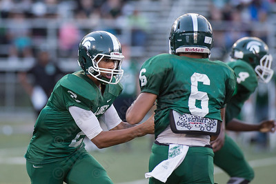 Maloney's Chris Dingwell (2) hands off to Alejandro Ortiz (6) Friday at Falcon Field in Meriden Sep. 11, 2015 | Justin Weekes / For the Record-Journal