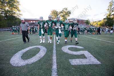 Maloney captain walk out for the coin flip Friday at Falcon Field in Meriden Sep. 11, 2015 | Justin Weekes / For the Record-Journal