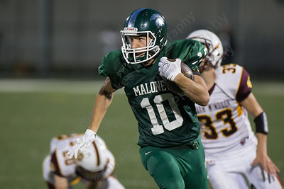 Maloney's Colton Altmannsberger (10) turns up field Friday at Falcon Field in Meriden Sep. 11, 2015 | Justin Weekes / For the Record-Journal
