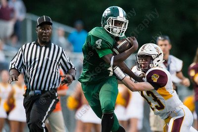 Maloney's Jaron Cigwell (4) gets forced out of bounds short of the goal line Friday at Falcon Field in Meriden Sep. 11, 2015 | Justin Weekes / For the Record-Journal