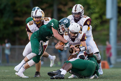 South Windsor's Jarod Sullivan (33) gets stopped by Maloney's Chad Smith (52) and Justin McEwen (3) Friday at Falcon Field in Meriden Sep. 11, 2015 | Justin Weekes / For the Record-Journal