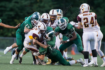 Maloney's defense stops South Windsor's Ben Cister (2) at the line Friday at Falcon Field in Meriden Sep. 11, 2015 | Justin Weekes / For the Record-Journal