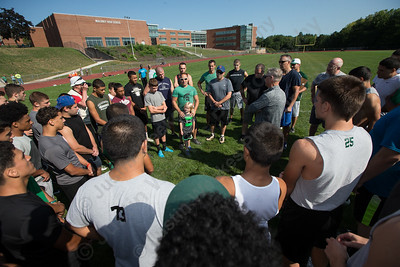 Former Maloney football players return to run the Greenbay, a running drill the late Maloney head coach Rob Szymaszek borrowed from the Greenbay Packers Sunday at Maloney High School in Meriden Sep. 4, 2016 | Justin Weekes / For the Record-Journal