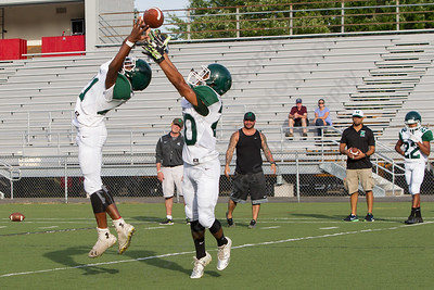 Maloney's Tyliq Rhodes (21) and Joshua Oquendo (20) run through receiver drills Friday during a pre season scrimmage with Berlin at Sage Park in Berlin Sep. 2, 2016 | Justin Weekes / For the Record-Journal
