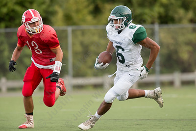 Maloney's Alejandro Ortiz turns up field after a reception Friday during a pre season scrimmage with Berlin at Sage Park in Berlin Sep. 2, 2016 | Justin Weekes / For the Record-Journal