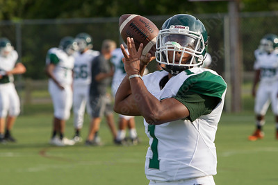 Maloney's quarterback Larue Graham warms up Friday during a pre season scrimmage with Berlin at Sage Park in Berlin Sep. 2, 2016 | Justin Weekes / For the Record-Journal