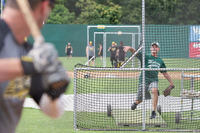 Maloney's head baseball coach Howard Hewitt throws batting practice to Bees first baseman Jonathan Griffin Tuesday at New Britain Stadium Jul. 19, 2016 | Justin Weekes / For the Record-Journal