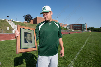 Maloney's head football coach Kevin Frederick holds the Rob Szymaszek memorial plaque before the running of the Greenbay, a running drill from the Greenbay Packers Sunday a Maloney High School in Meriden Sep. 4, 2016 | Justin Weekes / For the Record-Journal