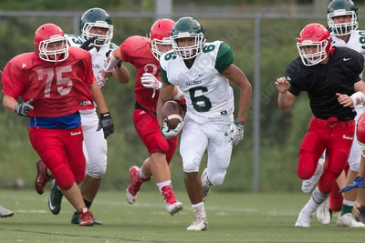 Maloney's Alejandro Ortiz breaks open up the middle Friday during a pre season scrimmage with Berlin at Sage Park in Berlin Sep. 2, 2016 | Justin Weekes / For the Record-Journal