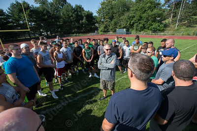 Maloney coach Mike Falis delivers an inspirational speech to former and current Maloney students Sunday at Maloney High School in Meriden. The group than ran Greenbay Packers running drill called the Greenbay in remembrance of the late Maloney coach Rob Szymaszek.  Sep. 4, 2016 | Justin Weekes / For the Record-Journal