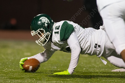 Maloney's Cruz Lenhart recovers his own fumble Tuesday during the CIAC Class L quarterfinals at Jack O'Brien Stadium in Wndsor November 28, 2017   Justin Weekes / For the Record-Journal
