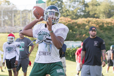 Maloney's Larue Graham throws a pass during practice Wednesday at Maloney High School in Meriden  Aug. 23, 2017 | Justin Weekes / For the Record-Journal