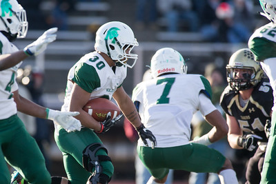 Maloney's Freddy Hidalgo looks for running room inside Saturday during the CIAC Class L final at Veterans Stadium in New Britain  December 8, 2018 | Justin Weekes / Special to the Record-Journal