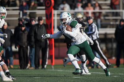 Maloney's Kamron Moreno returns a kick off Saturday during the CIAC Class L final at Veterans Stadium in New Britain  December 8, 2018 | Justin Weekes / Special to the Record-Journal