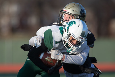Maloney's Vincent Martinez tries to break the tackle attempt from Hand's Ian Butler Saturday during the CIAC Class L final at Veterans Stadium in New Britain  December 8, 2018 | Justin Weekes / Special to the Record-Journal