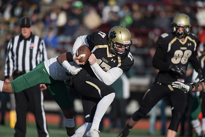 Hand's quarterback fights off a tackle attempt from Maloney's Jaylon Nixon  Saturday during the CIAC Class L final at Veterans Stadium in New Britain  December 8, 2018 | Justin Weekes / Special to the Record-Journal