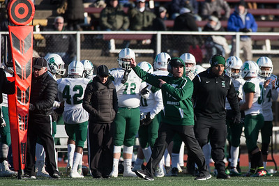 Maloney's Head coach Kevin Frederick gives direction to his defense Saturday during the CIAC Class L final at Veterans Stadium in New Britain  December 8, 2018   Justin Weekes / Special to the Record-Journal
