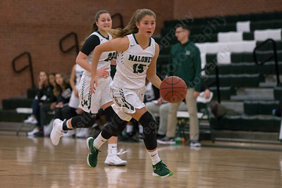 Maloney's Alexa Papallo pushes up court on a fast break Monday during the season opener at Maloney High School in Meriden December 11, 2017 | Justin Weekes / For the Record-Journal