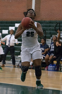 Maloney's Courtney Ubaike gets open underneath for two Monday during the season opener at Maloney High School in Meriden December 11, 2017   Justin Weekes / For the Record-Journal