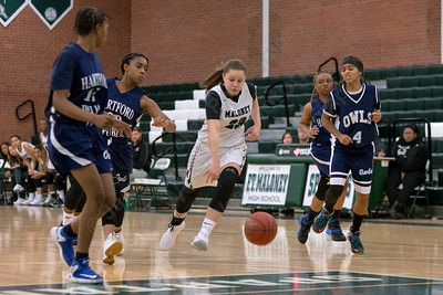 Maloney's Melanie Polanco drives the lane Monday during the season opener at Maloney High School in Meriden December 11, 2017 | Justin Weekes / For the Record-Journal