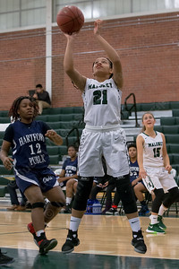 Maloney's Dasia White puts in a layup off a fast break Monday during the season opener at Maloney High School in Meriden December 11, 2017 | Justin Weekes / For the Record-Journal