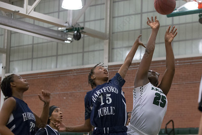 Maloney's Courtney Ubaike reaches for a rebound with Hartford Public's Janai Oliver Monday during the season opener at Maloney High School in Meriden December 11, 2017 | Justin Weekes / For the Record-Journal