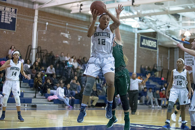 Platt's Madison Chatman  comes down with a rebound Thursday at Platt High School in Meriden January 18, 2018 | Justin Weekes / Special to the Record-Journal