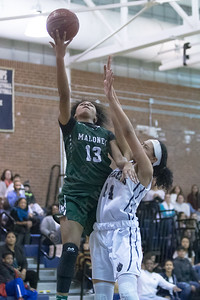 Maloney's Ivori-Gem Johnson puts in a layup Thursday at Platt High School in Meriden January 18, 2018 | Justin Weekes / Special to the Record-Journal