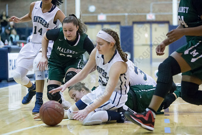 Platt's Julia Misner and Maloney's Melanie Polanco  dive after a loose ball Thursday at Platt High School in Meriden January 18, 2018 | Justin Weekes / Special to the Record-Journal