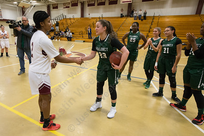 Maloney's Melanie Polanco gets congratulated by Bulkeley's Tyanna Jiles  after a break in play to recognize Polanco 1000 point achievement Thursday at Bulkeley High School in Hartford January 25, 2018 | Justin Weekes / Special to the Record-Journal