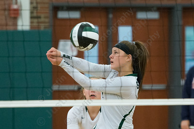 Maloney's Melanie Polanco digs a touch over the net Wednesday at Maloney High School in Meriden September 13, 2017   Justin Weekes / For the Record-Journal