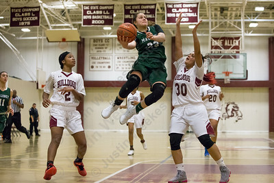 Maloney's Melanie Polanco puts in a layup for two points Thursday at Bulkeley High School in Hartford January 25, 2018 | Justin Weekes / Special to the Record-Journal