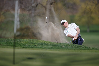 Maloney's Demetre Carnot plays out of a green side bunker on the second hole Tuesday at Hunter Golf Course in Meriden May 1, 2018 | Justin Weekes / Special to the Record-Journal
