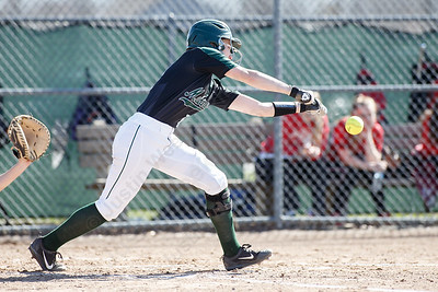 Maloney's Regan Maloney gets a bunt in play for a base hit Monday at Dunn Sports Complex in Meriden April 23, 2018 | Justin Weekes / Special to the Record-Journal