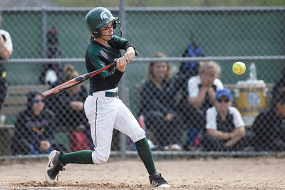 Maloney's Haley Kennedy drives a base hit to left field Thursday at Dunn Sports Complex in Meriden May 10, 2018 | Justin Weekes / Special to the Record-Journal